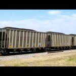 BNSF SD70ACe 9164 and SD70MAC 9694 lead a loaded coal train south of St. Joseph, Missouri