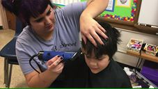 Stylists from Edmond Street Parlor treated kids at Pickett Elementary