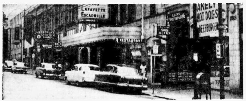 1958 on the south side of 7th & Edmond. Spector's Sporting Goods. The Electric Theater. Electric Shoe Repair, and Wakeley's Hot Dogs & Beefburgers