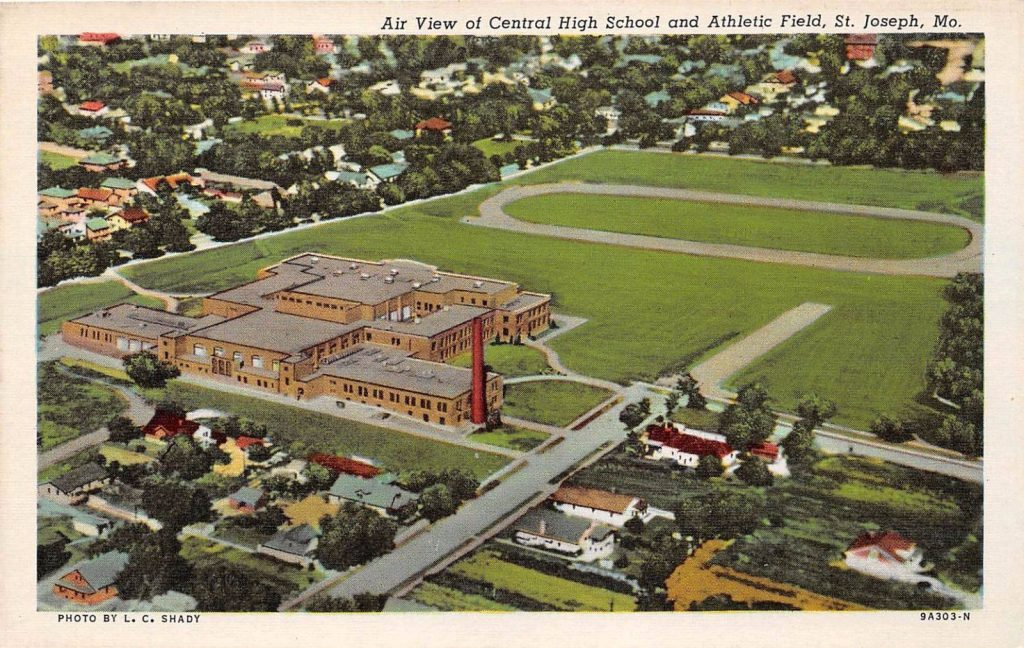 AIR VIEW CENTRAL HIGH SCHOOL & ATLETIC FIELD FROM THE REAR OF THE BUILDING POSTCARD c1930s