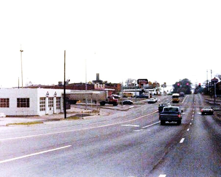 Belt & Mitchell 1977. Belt Super Market & D-X Gas Station in view