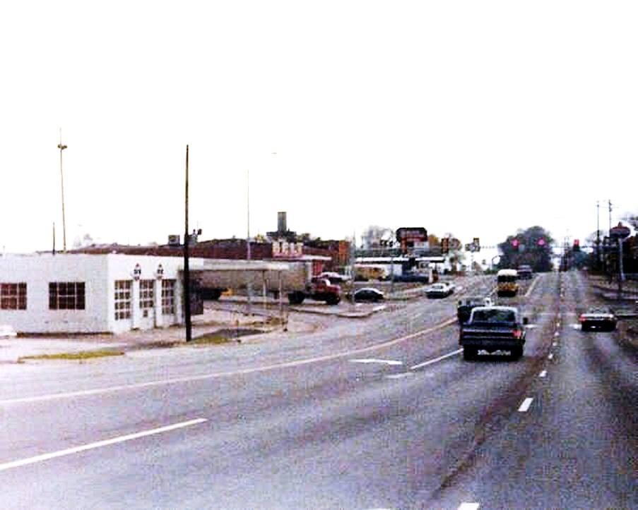 Belt & Mitchell 1977. Belt Super Market & D-X Gas Station in view