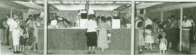 """Full house on July 25, 1949 as the Skylark has its grand opening with """"South of St. Louis"""" and people here at the concession stand."""