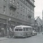 Krug Park Bus taking on Passengers in front of Lee's Records in the St. Francis Hotel