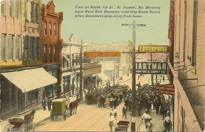 S. 6th St with Enterprise & Hartman Furniture Signs. Mund the Hatter, and the Hotel Ryan in the background.